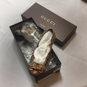 Authentic Gucci flats with gold and leather trim